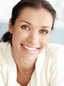 An attractive, middle aged woman giving you a cute smile